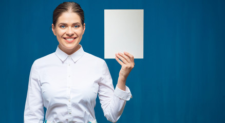 woman wearing white shirt holding empty sign board