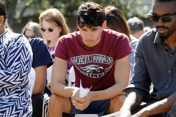 Student mourns at a community prayer vigil at Parkridge Church in Pompano Beach