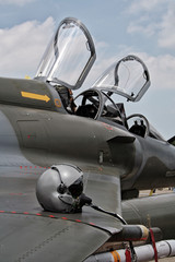 Pilot helmet on the wing of a fighter jet