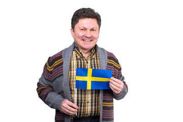Adult man with a flag of Sweden in his hands. An ordinary Swedish man.