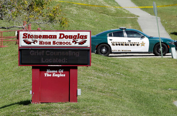 A message about grief counseling appears on the electronic signboard at Marjory Stoneman Douglas High School in Parkland