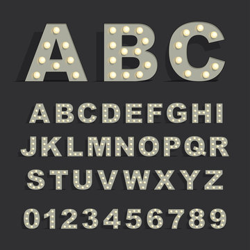 Font with lamps on black background