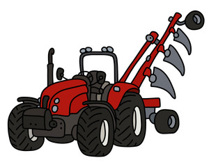 The red tractor with the plow