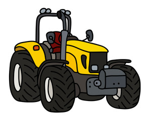 The yellow open heavy tractor