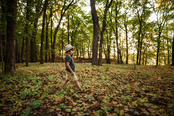 Boy walking through the forest