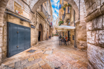 Alleyway in old white town Bari