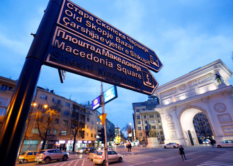 A sign points towards Macedonia Square in Skopje