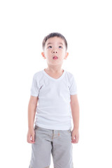 Little asian boy in white T-shirt standing over white background