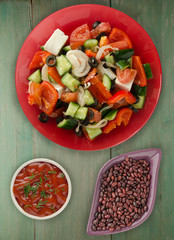 Greek salad on a wooden background