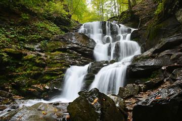 Waterfall Shypit, cascade in Pylypets in the autumn forest. Carpathian Mountains, Zakarpatska oblast, Ukraine.