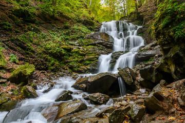 Waterfall Shypit, cascade in Pylypets in the autumn forest. Carpathian Mountains, Zakarpatska oblast, Ukraine. Wall mural