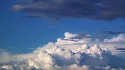 Fotobehang - Epic white cumulus clouds timelapse. 4K UHD.