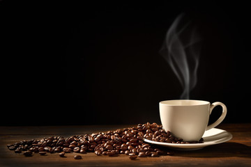 Cup of coffee with smoke and coffee beans on black background, This image with no smoke is available