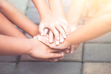 Children holding hands and playing together with unity and teamwork