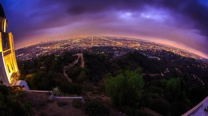 Klistermärke - Zoom in city Los Angeles skyline sunset night Fisheye perspective 4K Timelapse