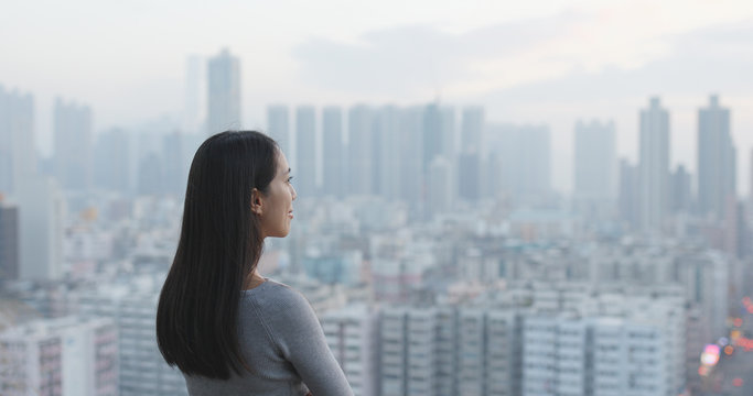 Woman looking at the city view