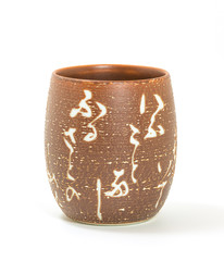 Ceramic tea glass Japanese style at center of image on white background