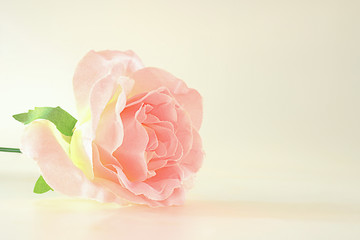 Artificial flowers are placed on a white background.