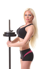 sports fitness girl with a barbell