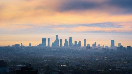 Fototapete - Beautiful sunrise over city of Los Angeles downtown skyline. 4K UHD timelapse.