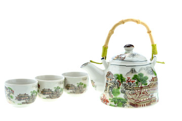 Teapot with cups on a white background.