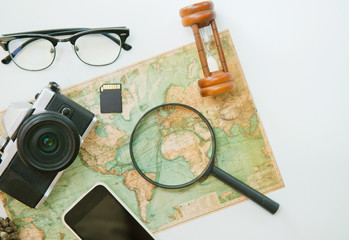 top view of Traveler accessories, Travel concept, Travel and Holiday on world map, camera and eyeglasses, summer time, Vacation, Essential vacation items, flat lay of accessories