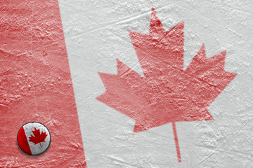 Image of the Canadian flag on ice with a washer