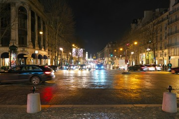 Paris,France-January 27, 2018: Night scene of Rue Royale from the Madeleine Church. Obelisk of Place de Concorde is recognizable.