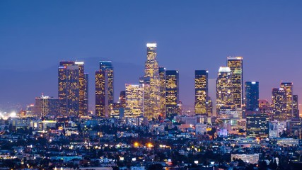Fototapete - Downtown Los Angeles skyline change from twilight to night city 4K UHD Timelapse
