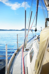 View from the left side deck of a small yacht sailing in an open sea during the day