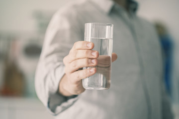 Male holding glass of water