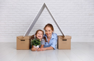 concept of housing, mortgage and relocation family mother and child with roof and boxes