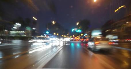Fotobehang - POV driving plates Los Angeles Santa Monica Blvd rain at night in West Hollywood
