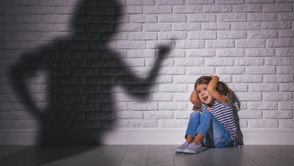 domestic violence. angry mother scolds   frightened daughter .