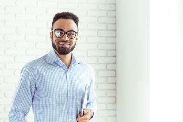 Portrait of happy afroamerican man using laptop comruter