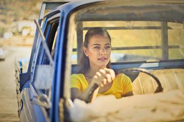 Beautiful girl driving a truck