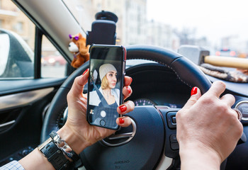 Women is making a selfie while driving