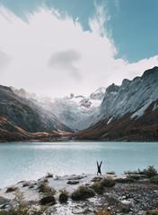 Tourist upside down at mountain lake