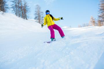 Foto op Plexiglas Wintersporten Photo of sports woman wearing helmet and snowboarding mask from snowy slope with trees