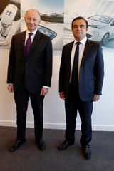 Carlos Ghosn, Chairman and CEO of Renault, and Thierry Bollore, Renault Chief Operating Officer, pose after the presentation of the French carmaker Renault's 2017 annual results  in Boulogne-Billancourt