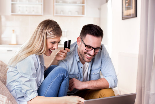 Young couple shopping online at home