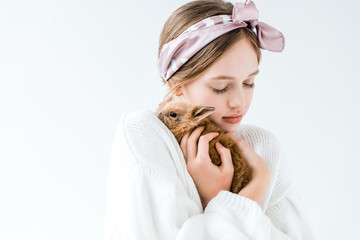 beautiful girl holding adorable furry bunny isolated on white