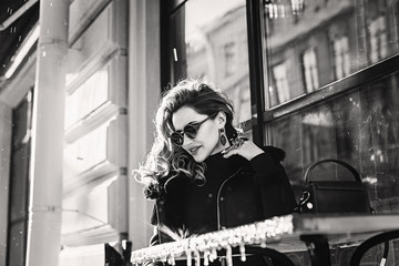 Fashionable Woman sitting in Street Cafe, Black and White Photo