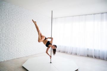 A beautiful young gymnast dancing training