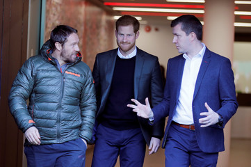 Britain's Prince Harry attends England rugby team open training session at Twickenham Stadium in London