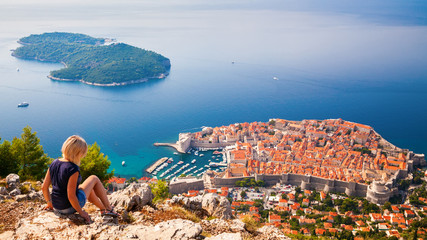 woman looking at the Dubrovnik Old Town