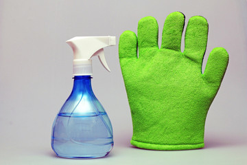 Sprays for cleaning and sponge on a white background