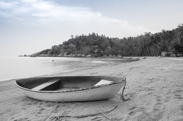 Black and white Beautiful beach with motor boat at toa island, Thailand