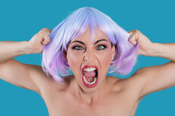 Frustrated nervous woman holding hair