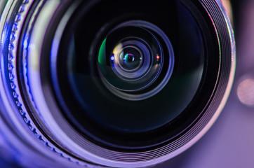 The camera lens and blue backlighting . Horizontal photo